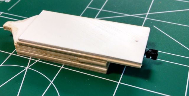 On the left is a tab for sliding under cars to verify that the body of a car is at the proper height.  At right, a KD-714 HOn3 coupler has been added.