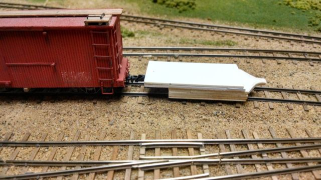 A coupler height check.  This gauge does not yet have anything to center the gauge on the rails, but that should be easy enough to add.